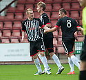 Pars' Andrew Geggan (6) celebrates with Robert Thomson (centre) and Stephen Husband (8) after he scores their first goal.