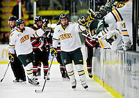26 November 2010: University of Vermont Catamount defenseman Drew MacKenzie, a Junior from New Canaan, CT, skates past his bench after scoring the first goal of the game against the Northeastern University Huskies at Gutterson Fieldhouse in Burlington, Vermont. MacKenzie netted a goal and an assist for the Cats, but the Huskies came back from a 2-0 deficit to earn a 2-2 tie. Mandatory Credit: Ed Wolfstein Photo