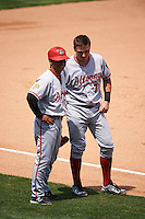 Altoona Curve catcher Reese McGuire (7) and manager Joey Cora (5) during a game against the Erie SeaWolves on July 10, 2016 at Jerry Uht Park in Erie, Pennsylvania.  Altoona defeated Erie 7-3.  (Mike Janes/Four Seam Images)