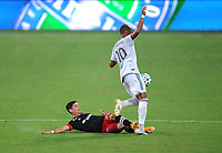 WASHINGTON, DC - AUGUST 25: Joseph Mora #28 of D.C. United battles for the ball with Teal Bunbury #10 of New England Revolution during a game between New England Revolution and D.C. United at Audi Field on August 25, 2020 in Washington, DC.