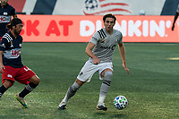 FOXBOROUGH, MA - SEPTEMBER 23: Luis Binks #5 of Montreal Impact dribbles at midfield as Lee Nguyen #42 of New England Revolution defends during a game between Montreal Impact and New England Revolution at Gillette Stadium on September 23, 2020 in Foxborough, Massachusetts.