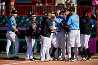 Erie SeaWolves Kody Eaves (22) is congratulated by teammates, including Kade Scivicque, Isaac Paredes, Josh Lester, Chace Numata, Matt Manning, Zac Houston, and  Anthony Castro, after hitting a walk off home run during an Eastern League game against the Akron RubberDucks on June 2, 2019 at UPMC Park in Erie, Pennsylvania.  Erie defeated Akron 8-5 in eleven innings in the second game of a doubleheader.  (Mike Janes/Four Seam Images)