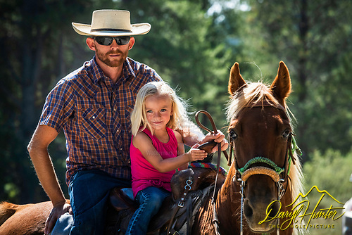 Litlle cowgirl and ranching dad