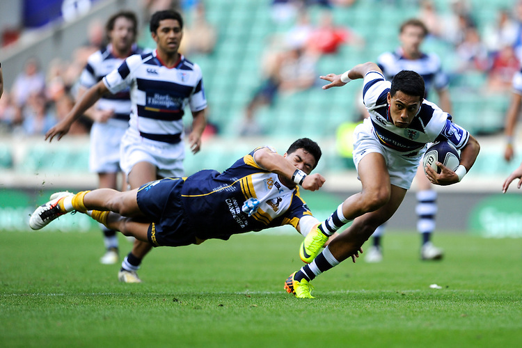 Kali Hala of Auckland escapes the clutches of Rodney Iona of the Brumbies to score a try during the World Club 7s at Twickenham on Sunday 18th August 2013 (Photo by Rob Munro)