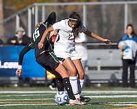 College of St Rose forward Amanda Vasquez (7) works to clear ball as Wilmington University defender Morgan Fraczkowski (15) defends.. In 2012 NCAA Division II Women's Soccer Championship Tournament First Round, College of St Rose (white) defeated Wilmington University (black), 3-0, on Ronald J. Abdow Field at American International College on November 9, 2012.