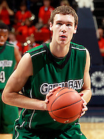 CHARLOTTESVILLE, VA- NOVEMBER 26:  Alec Brown #21 of the Green Bay Phoenix handles the ball during the game on November 26, 2011 at the John Paul Jones Arena in Charlottesville, Virginia. Virginia defeated Green Bay 68-42. (Photo by Andrew Shurtleff/Getty Images) *** Local Caption *** Alec Brown