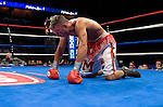 Bronco McKart on the canvas after being knocked down , tries to catch his breath  during his NABF Middleweight Title against Kelly Pavlik at the Mohegan Sun Arena on 07.27.06. Pavlik won by a 6th round knock out.