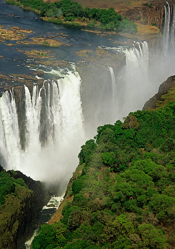 Victoria Falls on the Zambezi River, from Zimbabwe.  The falls plunge 100 m into a chasm creating their own unique saturated environment.