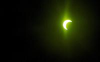 Moon eclipsing the sun May 20, 2012 shot through a welding helmet lens, thus the green color.