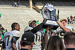 The Army MVP and captains celebrate after winning the Zaxby's Heart of Dallas Bowl game between the Army Black Knights and the North Texas Mean Green at the Cotton Bowl Stadium in Dallas, Texas.