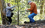 WOODBURY, CT. - 12 May 2021-051221SV01-From left, Carole Cheah, a research entomologist with the CT Agricultural Experiment Station, and Jim Sherman of The Woodbury Conservation Commission release lady beetle that eats the invasive Hemlock Woody Adelgid at Nonnawaug Falls in Woodbury Wednesday.<br /> Steven Valenti Republican-American