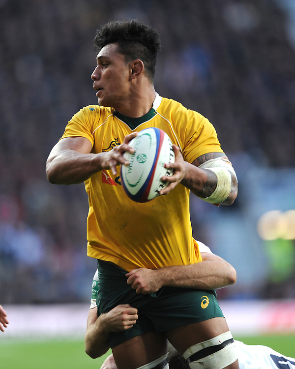 Lopeti Timani of Australia looks to offload during the Old Mutual Wealth Series match between England and Australia at Twickenham Stadium on Saturday 3rd December 2016 (Photo by Rob Munro)