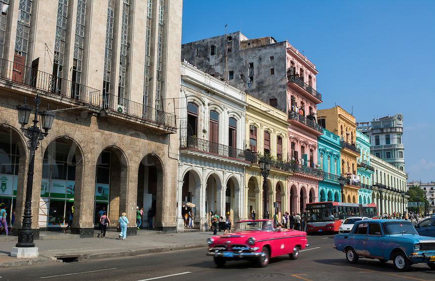 Havana Cuba old classic cars and taxis on street at Capital in downtown city of Habana with traffic and 1950s autos