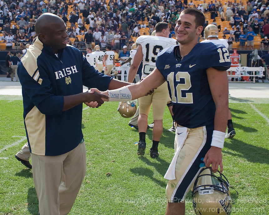 Pitt quarterback Tino Sunseri gets a handshake from a Notre Dame coach after the game. The Notre Dame Fighting Irish defeated the Pitt Panthers 15-12 at Heinz field in Pittsburgh, Pennsylvania on Septrmber, 24, 2011..