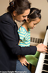Grade 1 girl in piano lesson at school for musically gifted children