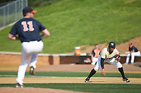 Christian Long (19) of the Wake Forest Demon Deacons takes his lead off of first base as Virginia Cavaliers pitcher Bennett Sousa (11) starts his wind-up at David F. Couch Ballpark on May 19, 2018 in  Winston-Salem, North Carolina. The Demon Deacons defeated the Cavaliers 18-12. (Brian Westerholt/Four Seam Images)