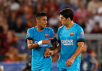 Calcio, Champions League, Gruppo E: Roma vs Barcellona. Roma, stadio Olimpico, 16 settembre 2015.<br /> FC Barcelona's Luis Suarez, right, is congratulated by his teammate Neymar after scoring during a Champions League, Group E football match between Roma and FC Barcelona, at Rome's Olympic stadium, 16 September 2015.<br /> UPDATE IMAGES PRESS/Riccardo De Luca<br /> <br /> *** ITALY AND GERMANY OUT ***