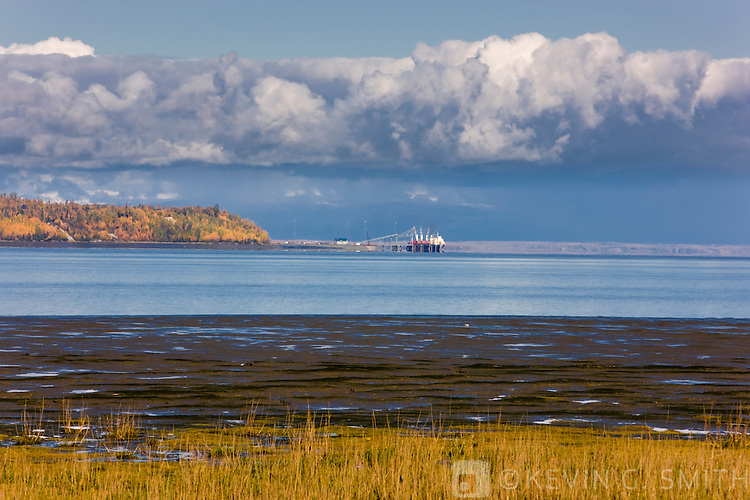 Cargo ship loading at Point Mckensie, Knik Arm, fall, Southcentral Alaska, USA.