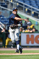 Cal State Fullerton Titans infielder Jerrod Bravo (12) throws to first during a game against the Louisville Cardinals on February 15, 2015 at Bright House Field in Clearwater, Florida.  Cal State Fullerton defeated Louisville 8-6.  (Mike Janes/Four Seam Images)