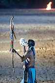 A contestant plays a conch shell during the closing event at the International Indigenous Games, in the city of Palmas, Tocantins State, Brazil. Photo © Sue Cunningham, pictures@scphotographic.com 31st October 2015