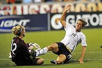 Kelly O'Hara collides with Kristin Hammarstrom...USWNT tied Sweden 1-1 at Morison Stadium, Nebraska.