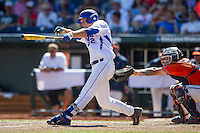 Florida Gators designated hitter JJ Schwarz (22) swings the bat against the Virginia Cavaliers in Game 11 of the NCAA College World Series on June 19, 2015 at TD Ameritrade Park in Omaha, Nebraska. The Gators defeated Virginia 10-5. (Andrew Woolley/Four Seam Images)