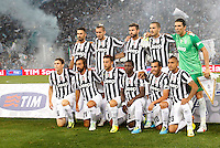 Calcio, Supercoppa di Lega: Juventus vs Lazio. Roma, stadio Olimpico, 18 agosto 2013.<br /> Juventus players pose prior to the start of the Italian League Supercup football final match between Juventus and Lazio, at Rome's Olympic stadium,  18 August 2013. Back row, from left, Mirko Vucinic, Giorgio Chiellini, Andrea Barzagli, Leonardo Bonucci, Gianluigi Buffon. Front row, from left, Stephan Lichsteiner, Andrea Pirlo, Claudio Marchisio, Kwadwo Asamoah, Carlos Tevez, Arturo Vidal<br /> UPDATE IMAGES PRESS/Isabella Bonotto