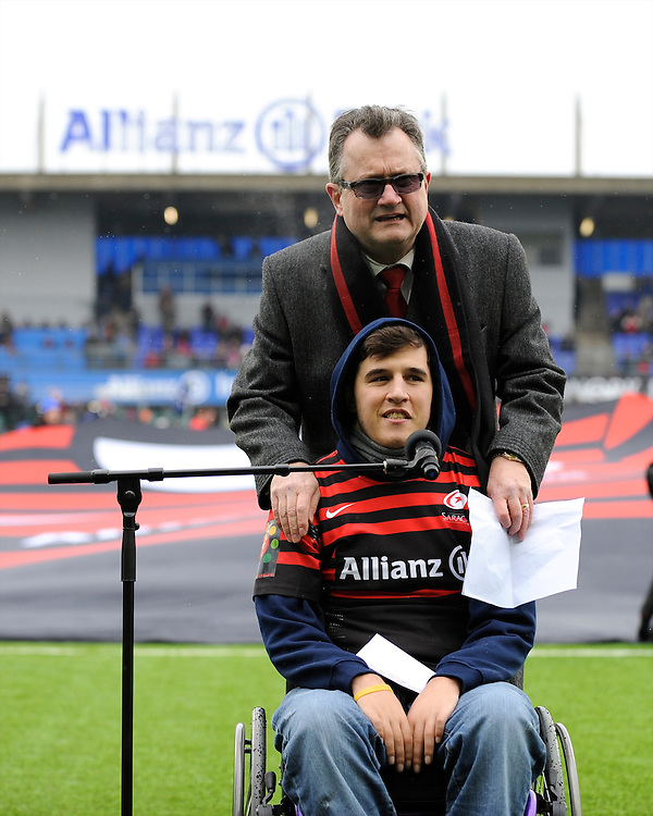 20130324 Copyright onEdition 2013©.Free for editorial use image, please credit: onEdition..Clem Booth, member of the Allianz Board of Management, stands with Henry Fraser (brother of Will Fraser) at the official opening of Allianz park before  the Premiership Rugby match between Saracens and Harlequins at Allianz Park on Sunday 24th March 2013 (Photo by Rob Munro)..For press contacts contact: Sam Feasey at brandRapport on M: +44 (0)7717 757114 E: SFeasey@brand-rapport.com..If you require a higher resolution image or you have any other onEdition photographic enquiries, please contact onEdition on 0845 900 2 900 or email info@onEdition.com.This image is copyright onEdition 2013©..This image has been supplied by onEdition and must be credited onEdition. The author is asserting his full Moral rights in relation to the publication of this image. Rights for onward transmission of any image or file is not granted or implied. Changing or deleting Copyright information is illegal as specified in the Copyright, Design and Patents Act 1988. If you are in any way unsure of your right to publish this image please contact onEdition on 0845 900 2 900 or email info@onEdition.com
