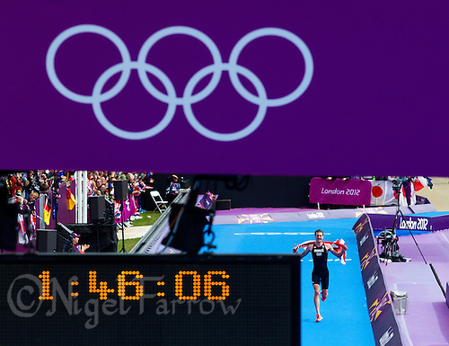 07 AUG 2012 - LONDON, GBR - Alistair Brownlee (GBR) of Great Britain celebrates winning the London 2012 Olympic Games Triathlon in Hyde Park, London, Great Britain .(PHOTO (C) 2012 NIGEL FARROW)