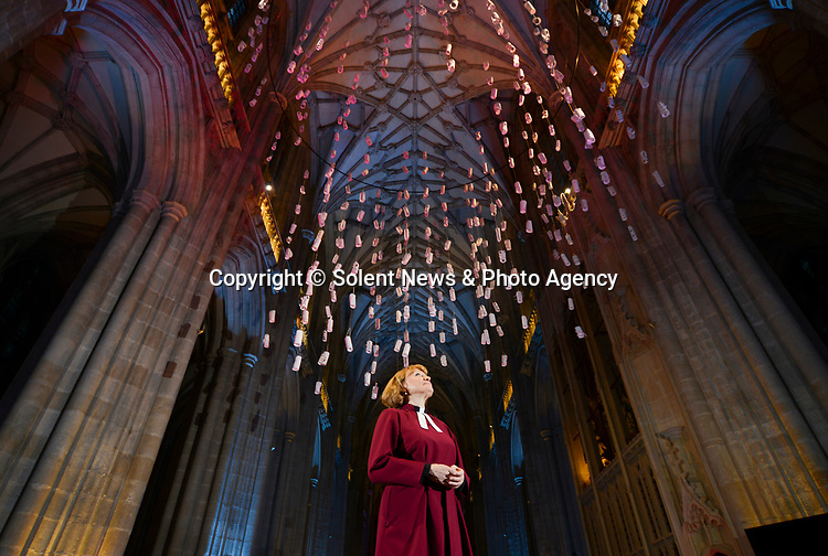 Pictured: Dean Catherine Ogle, marvelling at the new giant lantern project installation at WInchester Cathedral.<br /> <br /> The installation is made up of paper lanterns that have been inscribed with personal messages or prayers to loved ones from members of the public. They've then been strung together with string and then hung from the ceiling of the hall.<br /> <br /> The Cathedral is preparing for its upcoming Christmas services, with Dean Catherine Ogle leading many of them. She is the first female Dean in the Cathedrals history.<br /> <br /> © Ewan Galvin/Solent News & Photo Agency<br /> UK +44 (0) 2380 458800