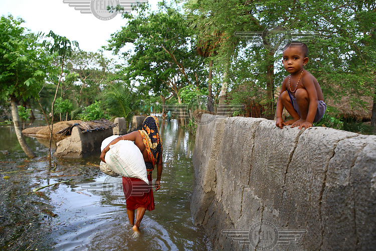 A child looks out over the floodwaters. Thousands of people were displaced in Shyamnagar Upazila, Satkhira district after Cyclone Aila struck Bangladesh on 25/05/2009, triggering tidal surges and floods..