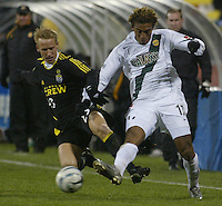Columbus Crew's David Testo (23) and Los Angeles Galaxy's Guillermo Ramirez (17) during the second half at Columbus Crew Stadium in Columbus, Ohio Saturday April 2, 2005.
