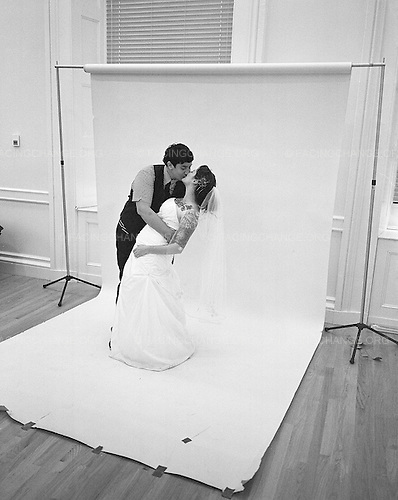 Brooklyn, New York<br /> July 24, 2011<br /> <br /> A lesbian couple kiss and pose for a photograph in Brooklyn's Borough Hall after getting married on the first day that it was legal to do so in New York State.