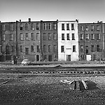 Abandoned row house apartments along railroad tracks. Somewhere in Pennsylvania. 1977