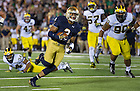 Sept. 6, 2014; Irish wide receiver Amir Carlisle heads for the end zone to score a touchdown during the second half against Michigan . (Photo by Barbara Johnston/ University of Notre Dame)