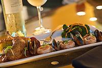 Paella à la Plancha.Tiger Prawns, Mussels,.Braised Chicken, Chorizo Sausage,.Saffron Sweet Pea Risotto Cake