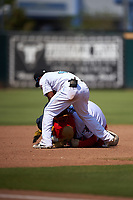 Inland Empire 66ers shortstop Luis Rengifo (3) helps a young contestant (not pictured) by wrestling with the 66ers mascot, Bernie, during a California League game against the Lancaster JetHawks at San Manuel Stadium on May 20, 2018 in San Bernardino, California. Inland Empire defeated Lancaster 12-2. (Zachary Lucy/Four Seam Images)