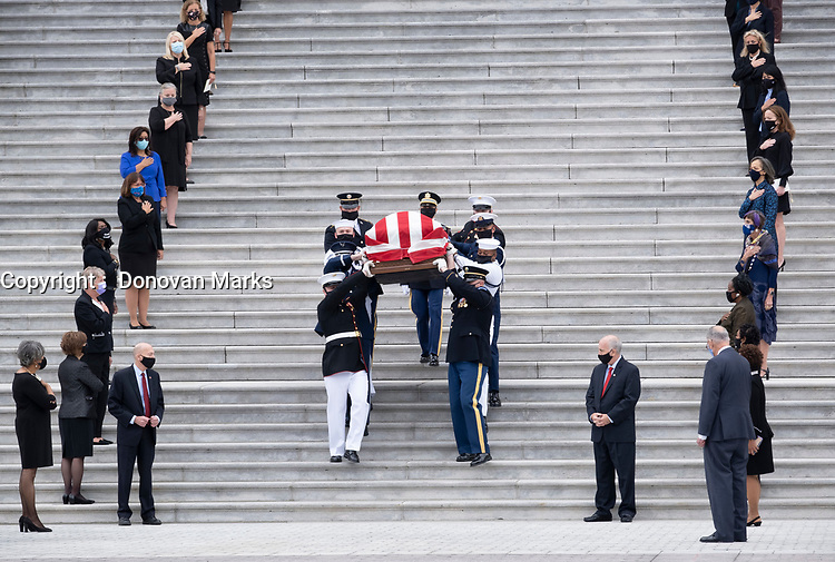 Sept. 25, 2020 - Washington--Following a private service in the rotunda, the body of Ruth Bader Ginsburg is carried down the steps of the Capitol, flanked by the women of Congress.<br /> <br /> PHOTO : Agence Quebec Presse