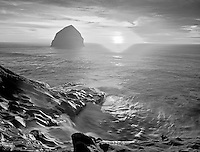 Sunset at Cape Kiwanda with wave covered rock. Oregon