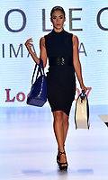 CALI - COLOMBIA - 21 - 09 – 2017: Modelo luce diseño de la colección Fascinacion, de la marca Sharline. El Teatro Calima es el escenario para la pasarela del Cali ExpoShow 2017. / Model looks design from the collection Fascinacion, Sharline brand. The Calima Theatre is the setting for the fashion catwalk  of the Cali ExpoShow 2017.Photo: Photo: VizzorImage / Luis Ramirez / Staff.