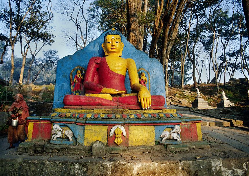Statue of the BUDDHA on the pathway to SWAYAMBUNATH STUPA - KATHAMANDU, NEPAL