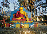 Statue of the BUDDHA on the pathway to SWAYAMBUNATH STUPA - KATHAMANDU, NEPAL