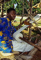 Korhogo, Ivory Coast, Cote d'Ivoire.  Young Senoufo Male Weaver at his Loom.