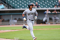 Montgomery Biscuits designated hitter Kaleo Johnson (17) hustles down the first-base line against the Tennessee Smokies on May 9, 2021, at Smokies Stadium in Kodak, Tennessee. (Danny Parker/Four Seam Images)