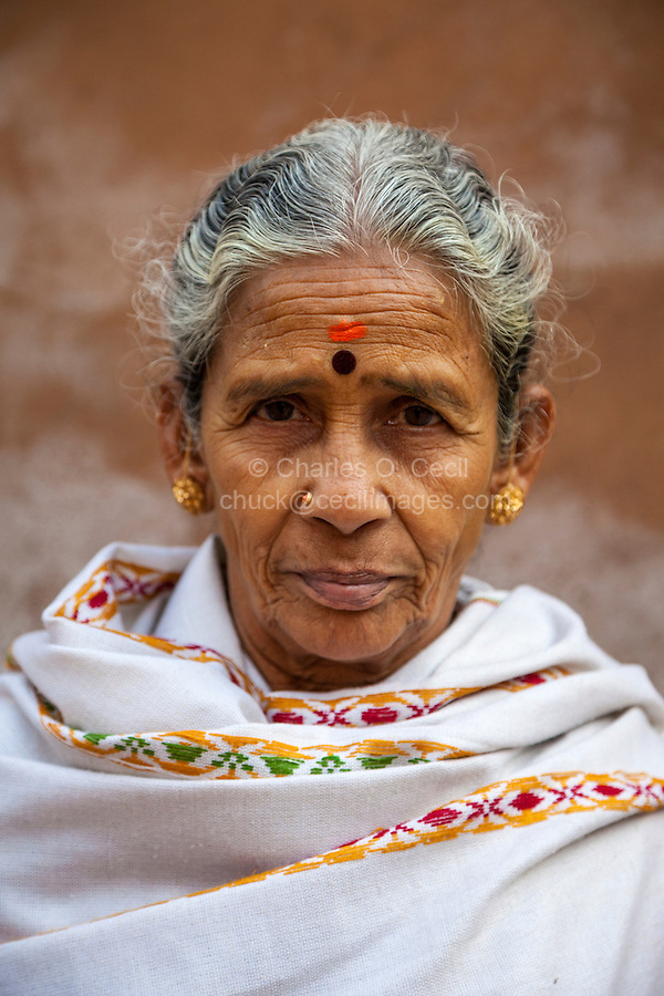 Agra, India.  Woman from Maharashtra State.   She has a bindi between her eyebrows, representing the third eye or spiritual sight that Hindus seek.  It is also said to protect against demons or bad luck.