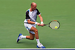SHANGHAI, CHINA - OCTOBER 16:  Nikolay Davydenko of Russia returns a shot against Radek Stepanek of the Czech Republic during day six of 2009 Shanghai ATP Masters 1000 at Qi Zhong Tennis Centre on October 16, 2009 in Shanghai, China. Photo by Victor Fraile / The Power of Sport Images