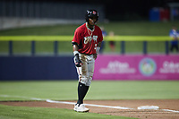 Arbert Cipion (3) of the Carolina Mudcats takes his lead off of third base against the Kannapolis Cannon Ballers at Atrium Health Ballpark on June 9, 2021 in Kannapolis, North Carolina. (Brian Westerholt/Four Seam Images)