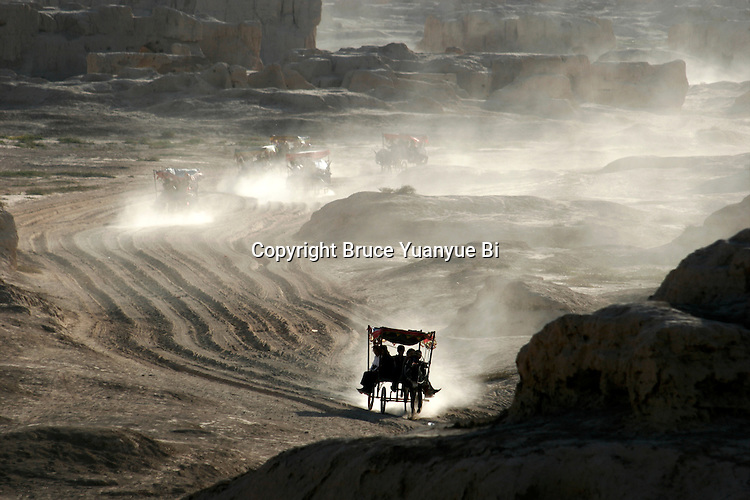 Donkey carriages in the ancient ruin city of Gao Chang, Turpan, Xinjiang Province, China