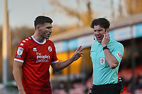 Jordan Tunnicliffe of Crawley Town chats with Referee Neil Hair during Crawley Town vs Barrow, Sky Bet EFL League 2 Football at Broadfield Stadium on 12th December 2020