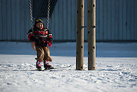 A student from Zackar Levi School in Lower Kalskag takes a break from skiing with Skiku coaches in front of his school. Skiku is a non-profit organization with the mission of creating a sustainable Nordic ski program in communities throughout Alaska. Volunteer coaches travel to villages each spring to instruct youngsters and distribute donated equipment with the goal of establishing ski programs at rural schools.  Photo by James R. Evans
